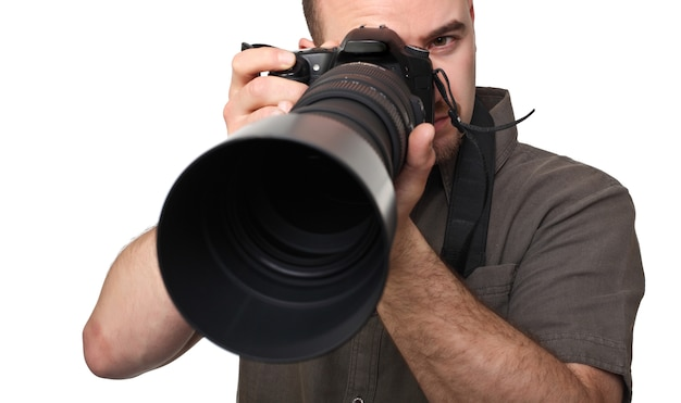 Man with big camera lens on white