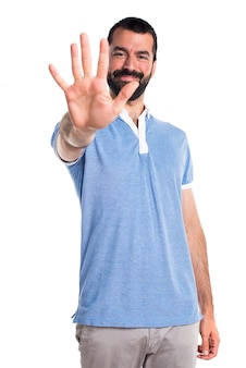 Man with blue shirt counting five