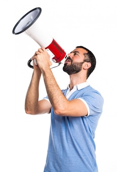 Man with blue shirt shouting by megaphone