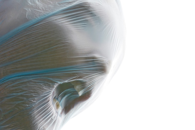 A man with blue transparent plastic bag over his head is suffocating. suffocation.