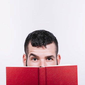 Man with book raising eyebrow