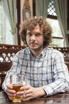 Man with booze resting in bar