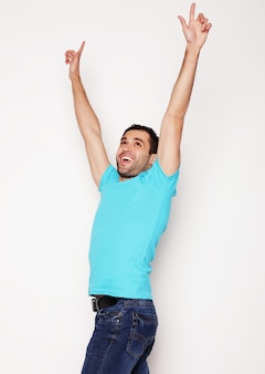 Man with both hands raised in the air.