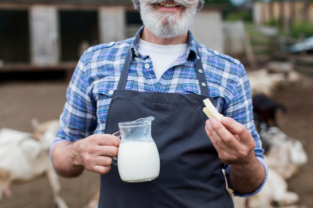 Man with bottle of goats milk close-up