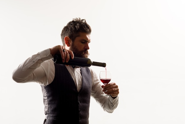 Man with bottle of wine red wine bearded man with alcohol man in suit drinks wine alcohol wine man