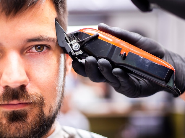 Man with brown eyes getting trimmed