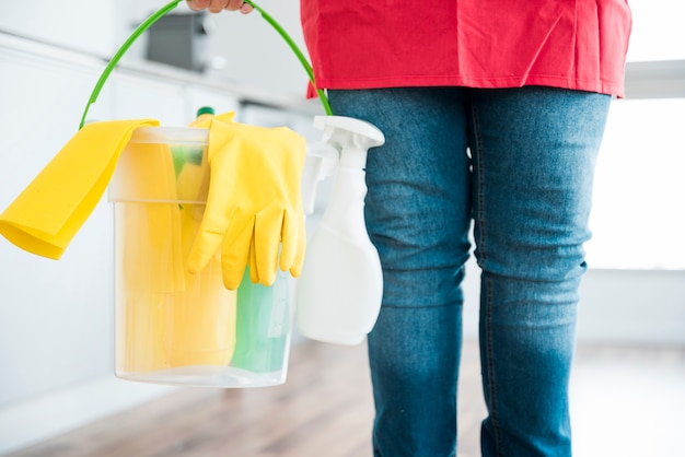 Man with bucket of cleaning products