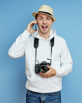 Man with a camera is happy