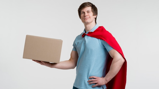 Man with cape and box