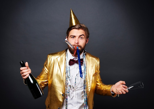 Man with champagne greeting new year