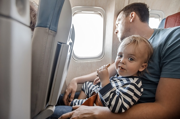 Man with charming infant in plane