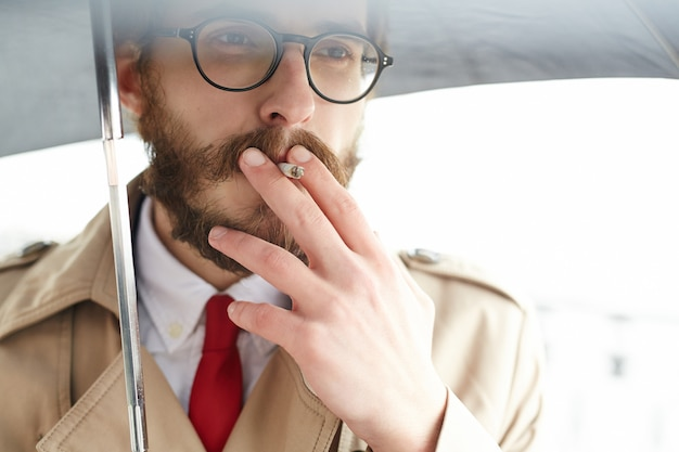 Man with cigarette Free Photo