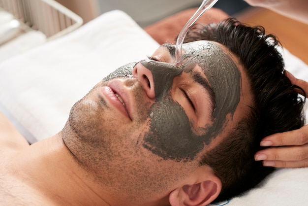 Man with clay mask