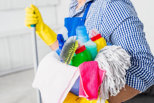 Man with cleaning products