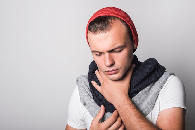 Man with closed eyes suffering from cough