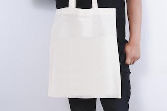 Man with cotton bag  shopping bags eco mockup
