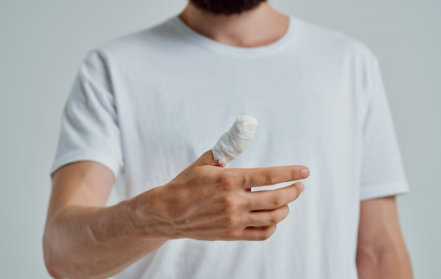 Man with cropped thumb health problems injury patient