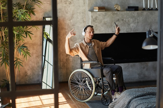 Man with disability enjoying music