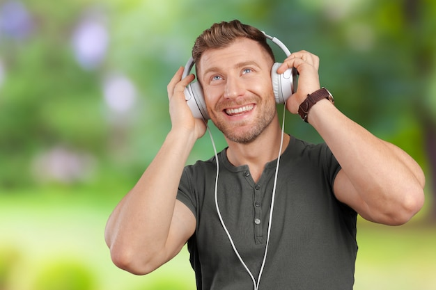 Man with earphones listening to music