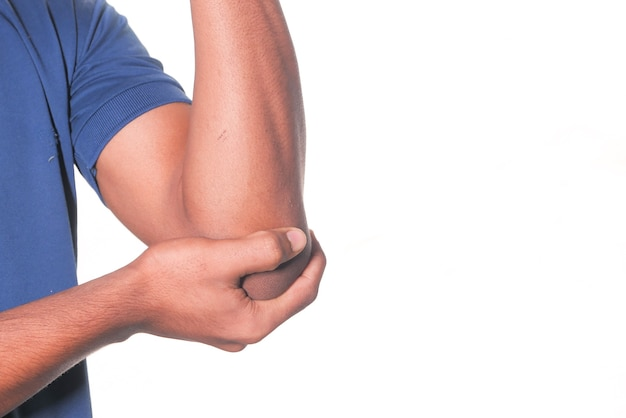 Man with elbow pain isolated in white. pain relief concept.