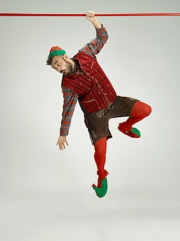 Man with elf costume isolated on white