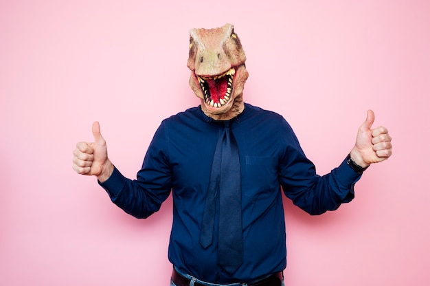 Man with euphoric dinosaur head and fingers up