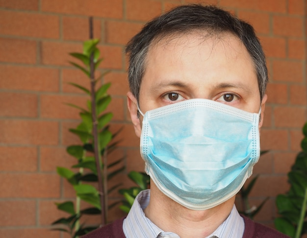 Man with facemask to stop spreading infection of respiratory ill