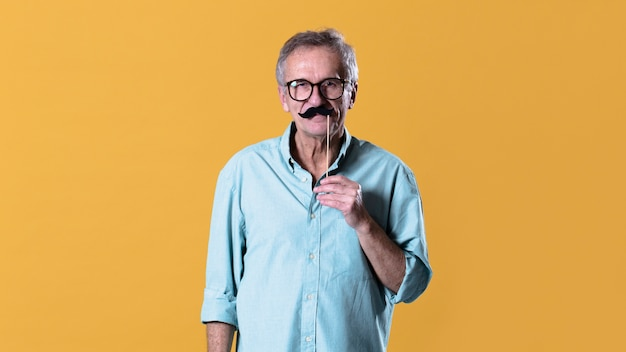 Man with fake mustache