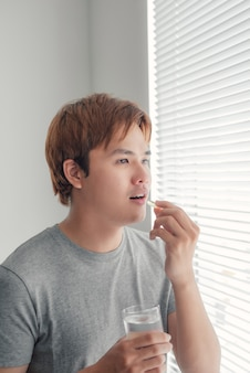 Man with fish oil capsules.