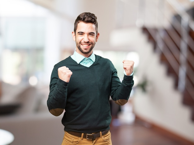 Man with fists raised celebrating