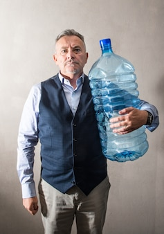 Man  with a giant water bottle