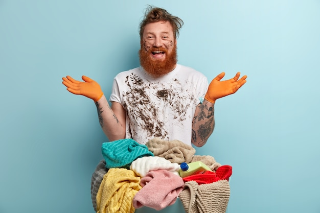 Man with ginger beard doing laundry