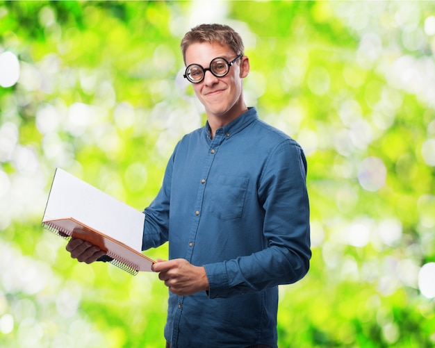 Man with glasses to see reading a notebook