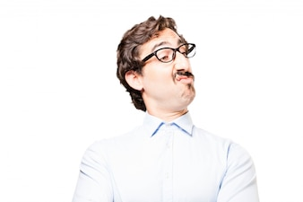 Man with glasses showing a funny face