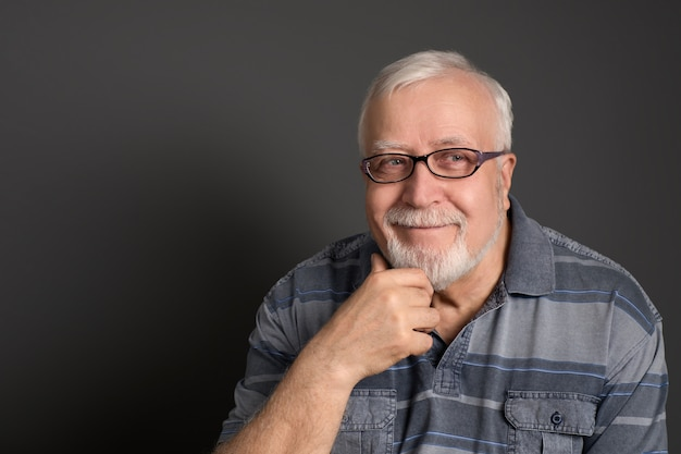 Man with glasses smiles good-naturedly