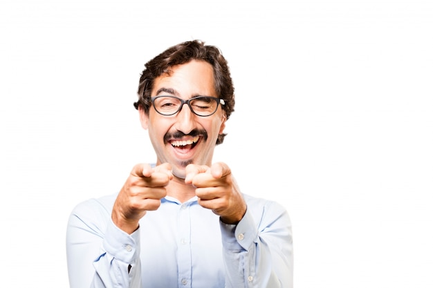 Man with glasses smiling and pointing