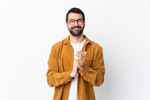 Man with glasses and yellow shirt
