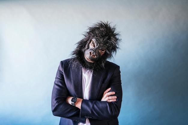 Man with gorilla mask posing Premium Photo