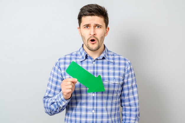 Man with green arrow pointing to the right and down