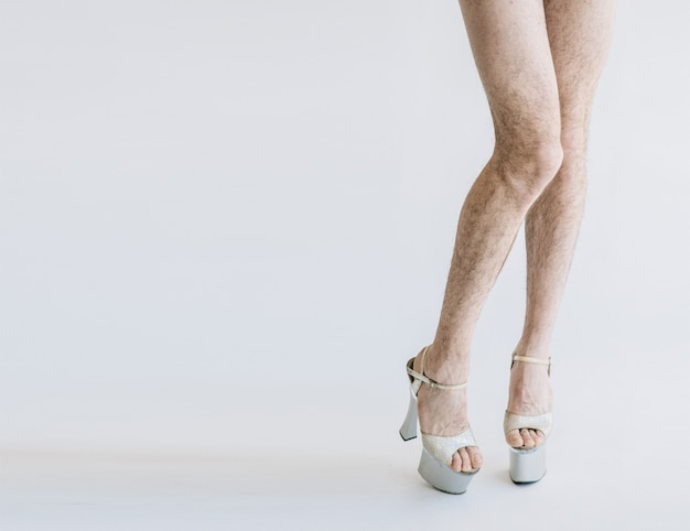 Man with hairy legs and high heels isolated, copy space
