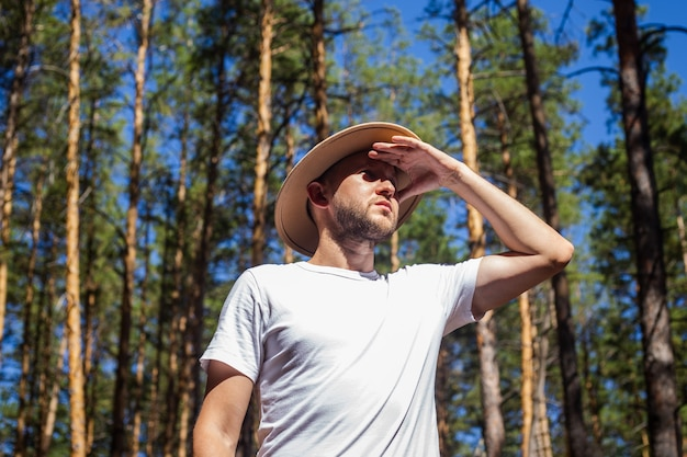 Man with a hat in the forest. hike in the mountains, forest.