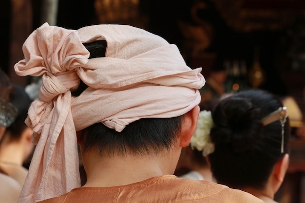Man with head fabric cover myanmar culture with chiang mai house, thailand