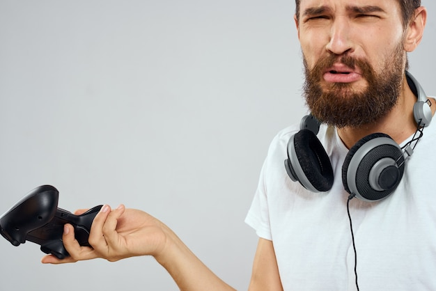 Man with headphones joystick in hands playing technology lifestyle. high quality photo