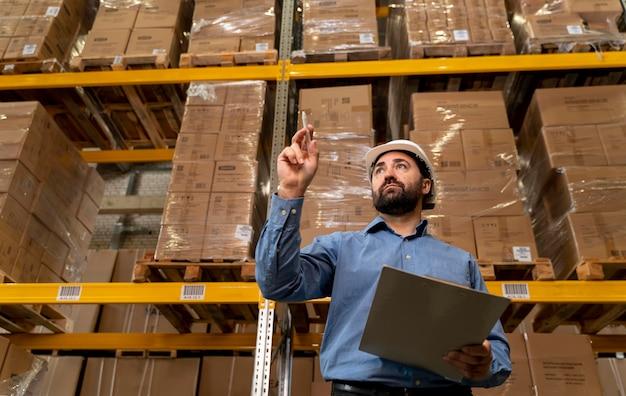 Man with helmet working in warehouse