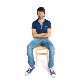 Man with his arms crossed over white background