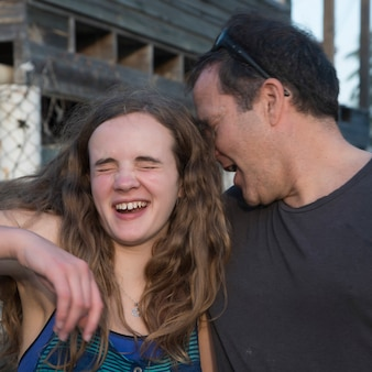 Man with his daughter, cayman cay, utila island, bay islands, honduras