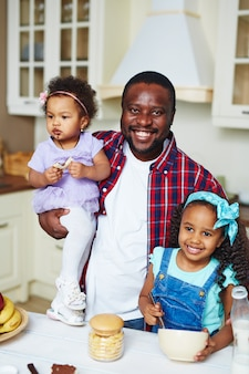 Man with his daughters
