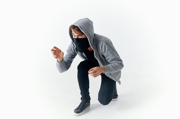 Man with a hood on his head anonymity hacker crime theft