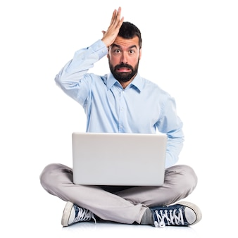 Man with laptop having doubts