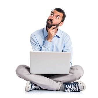 Man with laptop thinking
